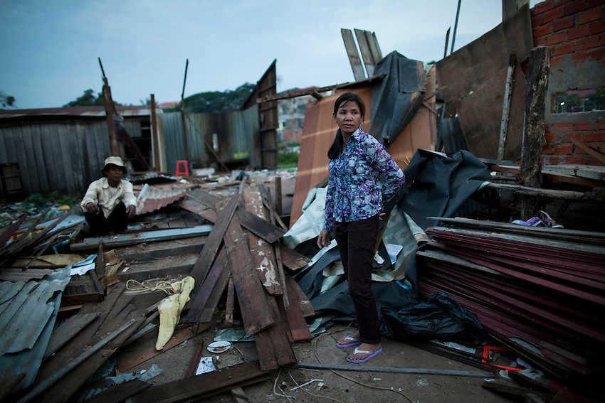 A woman from the Boeung Kak lake area stands amidst the ruins of her home, which was demolished to make way for Shukaku Inc's development.