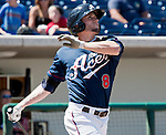 Reno Aces Tyler Kuhn watches his home run fly over the fience agianst the  Fresno Grizzlies on Sunday afternoon, August 26, 2012 in Reno, Nevada.