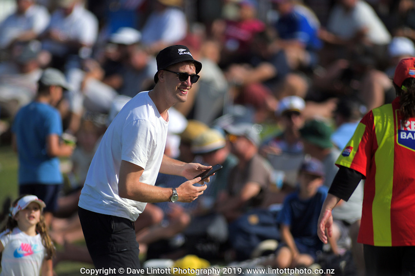 A fan chats with Red Badge security staff during day two of the international cricket 1st test match between NZ Black Caps and England at Bay Oval in Mount Maunganui, New Zealand on Friday, 22 November 2019. Photo: Dave Lintott / lintottphoto.co.nz