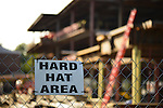 Garden City, New York, U.S. - August 29, 2014 - Adelphi University campus Hard Hat Area sign on chain link fence around Nexus and Welcome Center building construction, in summer