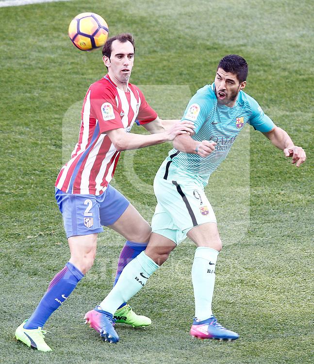 Atletico de Madrid's Diego Godin (l) and FC Barcelona's Luis Suarez during La Liga match. February 26,2017. (ALTERPHOTOS/Acero)