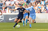 Bridgeview, IL, USA - Sunday, May 29, 2016: Sky Blue FC forward Kim DeCesare (12) and Chicago Red Stars defender Katie Naughton (5) during a regular season National Women's Soccer League match between the Chicago Red Stars and Sky Blue FC at Toyota Park. The game ended in a 1-1 tie.