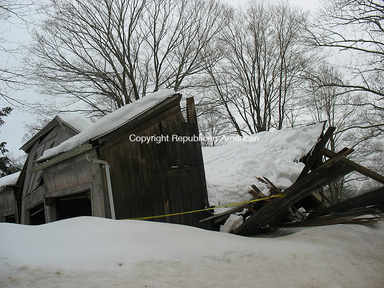 SOUTHBURY, CT. - 2 Feb. 2011 - 020211CG02 - An accumulation of ice and snow likely caused the collapse of this barn at 91 Library Road in Southbury on Wednesday afternoon. No one was injured, but the barn was a total loss. Chris Gardner Republican-American
