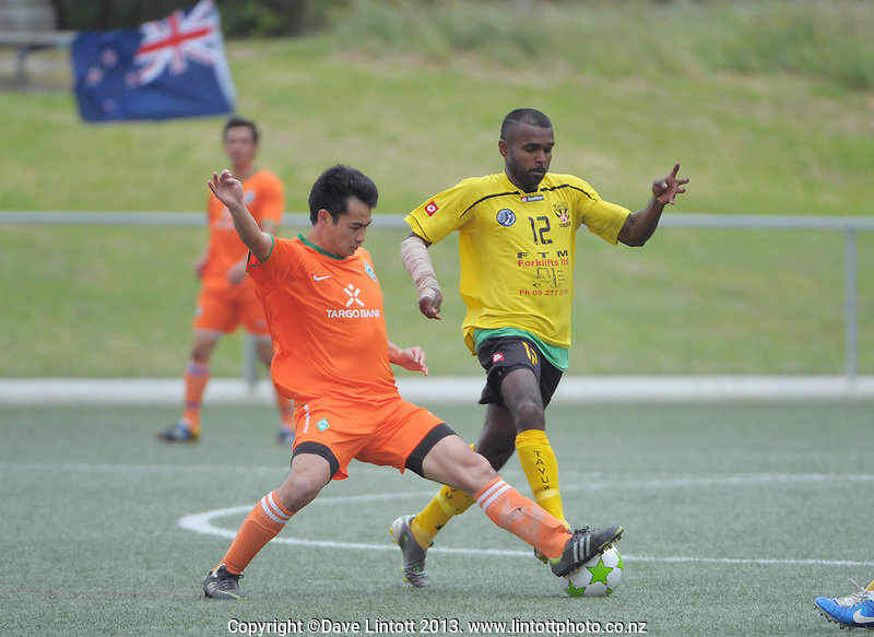 Action from the match between NZ Tavua FC (yellow) and Somalia (Wellington, orange) during the 2013 New Zealand Communities Cup football tournament at Wakefield Park,  Wellington, New Zealand, on Saturday, 30 November 2013. Photo: Dave Lintott / lintottphoto.co.nz