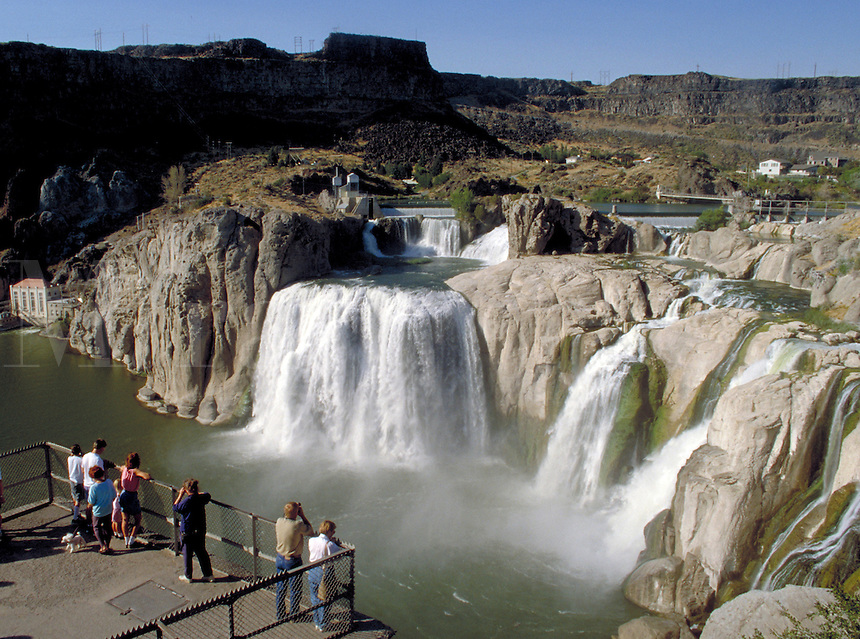 From a lookout point, a group of visitors or tourists enjoy the impressive view of the plumeting Shoshone Falls. Twin Falls Idaho.