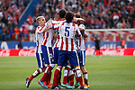 Atletico de Madrid´s Arda Turan celebrates a goal with his team mates during 2014-15 La Liga match between Atletico de Madrid and Deportivo de la Coruña at Vicente Calderon stadium in Madrid, Spain. November 30, 2014. (ALTERPHOTOS/Victor Blanco)