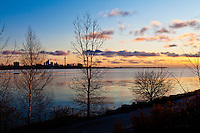 A view of the Toronto skyline at dawn over Lake Ontario