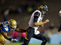 California quarterback Jared Goff runs the ball during the game against UCLA at Rose Bowl in Pasadena, California on October 12th, 2013.   UCLA defeated California, 37-10.