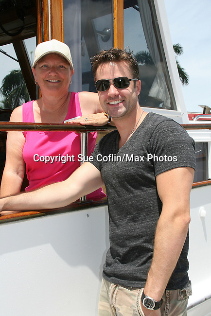John Driscoll - Y & R and GL poses with Joan - 12th Annual SoapFest - Actors take a break on the Ramblin' Rose with Ken as the captain on May 14, 2010 on Marco Island, FLA. (Photo by Sue Coflin/Max Photos)