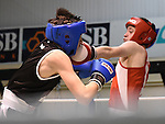 Tiernan Corrigan (in red) from Ardee boxing Club and Brandon Cassidy from Erne Boxing Club in action in the Louth Meath Boxing Championships held in Holy Family Boxing Club Ballsgrove.  Photo:Colin Bell/pressphotos.ie