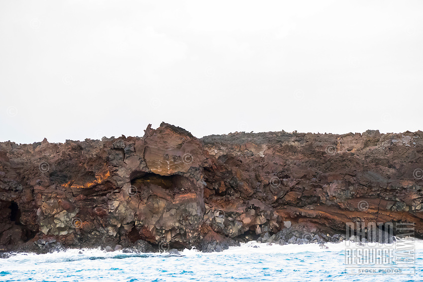 August 2018: The 35-year Kilauea eruption poured lava, now colorful hardened rock, along the Kapoho coastline, Puna, Big Island of Hawai'i.