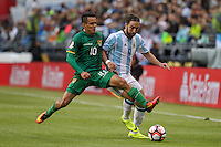 Seattle, WA - Tuesday June 14, 2016: Jhasmani Campos, Gonzalo Higuain during a Copa America Centenario Group D match between Argentina (ARG) and Bolivia (BOL) at CenturyLink Field.