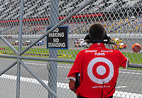 Jul. 3, 2008; Daytona Beach, FL, USA; A crew member for NASCAR Sprint Cup Series driver Reed Sorenson (not pictured) watches during practice for the Coke Zero 400 at Daytona International Speedway. Mandatory Credit: Mark J. Rebilas-