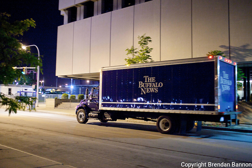 A delivery truck leaves early in the morning with the day's print edition from The Buffalo News building in downtown Buffalo, New York. The paper has been owned by Warren Buffett since 1977. Buffett announced the purchase of an additional 63 newspapers in May of 2012. Photo: Brendan Bannon, Buffalo, NY, June 8, 2012.