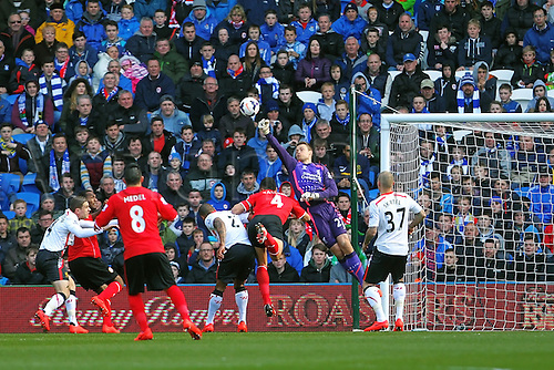 22.03.2014  Cardiff, Wales. Simon Mignolet of Liverpool  in action during the Premier League game between Cardiff City and Liverpool from Cardiff City Stadium.