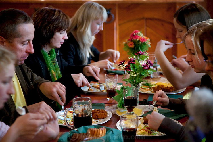 The Radzins family enjoys a traditional Sunday lunch at a neighborhood restaurant in Vecpiebalga, Latvia, complete with kvass, a fermented drink made from rye bread and sweetened with sugar or fruit. (From the book What I Eat: Around the World in 80 Diets.)