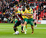 Kieron Freeman of Sheffield Utd tackled by Time Klose of Norwich City during the Championship match at Bramall Lane Stadium, Sheffield. Picture date 16th September 2017. Picture credit should read: Simon Bellis/Sportimage
