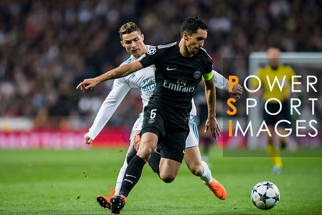 Marcos Aoas Correa, Marquinhos (R), of Paris Saint Germain fights for the ball with Cristiano Ronaldo of Real Madrid during the UEFA Champions League 2017-18 Round of 16 (1st leg) match between Real Madrid vs Paris Saint Germain at Estadio Santiago Bernabeu on February 14 2018 in Madrid, Spain. Photo by Diego Souto / Power Sport Images