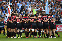 The Georgia team huddle together prior to kick-off. Rugby World Cup Pool C match between Argentina and Georgia on September 25, 2015 at Kingsholm Stadium in Gloucester, England. Photo by: Patrick Khachfe / Onside Images