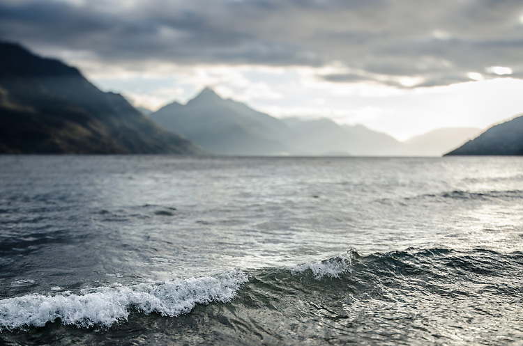 Wave and silhouetted  mountains - Lake Wakatipu, Queenstown, New Zealand - stock photo, canvas, fine art print