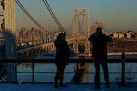 Sunset is seen over the George Washington Bridge from Fort Lee historic park in New Jersey. 28.02.2015. Kena Betancur/VIEWpress.