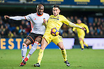Nicola Sansone (r) of Villarreal CF competes for the ball with Eliaquim Hans Mangala of Valencia CF during their La Liga match between Villarreal CF and Valencia CF at the Estadio de la Cerámica on 21 January 2017 in Villarreal, Spain. Photo by Maria Jose Segovia Carmona / Power Sport Images