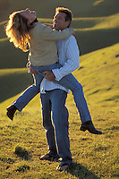 Happy couple fooling around, Mt. Tamalpais, N. California