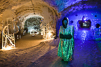 Yakutsk, Yakutia, Russia, 18/08/2011..A member of staff inside the Permafrost Kingdom, an underground tourist attraction inspired by the extreme cold of Yakutia. The 150 metre deep complex of tunnels in the Russian permafrost are decorated with ice sculptures, a wolf-fur covered throne, an office complete with the coolest computer and telephone, a children's slide and other ingenious creations - all hewn from blocks of ice.