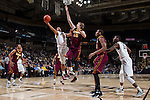Devin Thomas (2) of the Wake Forest Demon Deacons drives to the basket past Elliott Eliason (55) of the Minnesota Golden Gophers during second half action at the LJVM Coliseum on December 2, 2014 in Winston-Salem, North Carolina.  The Golden Gophers defeated the Demon Deacons 84-69. (Brian Westerholt/Sports On Film)