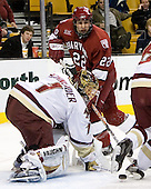 Dave Watters (Harvard University - Eden Prairie, MN) and Cory Schneider (Boston College - Marblehead, MA) eye the loose puck. The Boston College Eagles defeated the Harvard University Crimson 3-1 in the first round of the 2007 Beanpot Tournament on Monday, February 5, 2007, at the TD Banknorth Garden in Boston, Massachusetts.  The first Beanpot Tournament was played in December 1952 with the scheduling moved to the first two Mondays of February in its sixth year.  The tournament is played between Boston College, Boston University, Harvard University and Northeastern University with the first round matchups alternating each year.