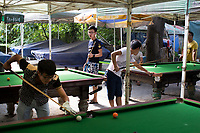 People play pool outside in Changle Park in Xian, Shaanxi Province, China.