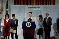 Washington, DC., USA, September 13, 1984<br /> President Ronald Reagan delivers remarks at a White House ceremony marking the opening of the National Center for Missing and Exploited Children. WIth him are John Walsh and his family and Senator Paula Hawkins (R-FL). Credit: Mark Reinstein/MediaPunch