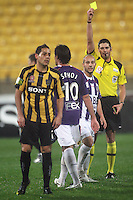 Perth's Adriano Pellegrino is yellow-carded for a challenge on Leo Bertos (left), who scored the winning goal from the resulting free kick during the A-League football match between Wellington Phoenix and Perth Glory at Westpac Stadium, Wellington, New Zealand on Sunday, 16 August 2009. Photo: Dave Lintott / lintottphoto.co.nz