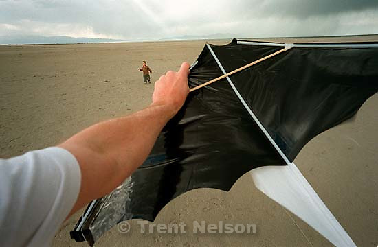 Trent Nelson and Noah Nelson at the Salt Lake flying a kite.<br />