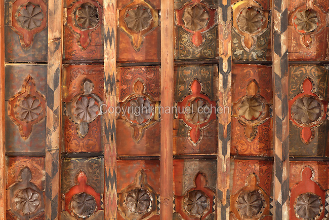 Detail of the ceiling of the Upper Hermitage of the Santuario de la Virgen de la Fuente, or Sanctuary of the Virgin of the Fountain, showing mudejar wooden panelling with carved and painted floral and vegetal decoration, Penarroya de Tastavins, Matarrana, Teruel, Aragon, Spain. In the 13th century, an image of the Virgin Mary was discovered beside a spring in this spot, and a chapel was built, which was replaced in the 14th century by a Gothic building. The Upper Hermitage was begun in 1341 in Aragonese Gothic style. It has one nave in 5 sections with a wooden roof decorated in mudejar style, with Calatrava crosses and heraldic symbols. The hermitage was declared a Spanish National Monument in 1941 and a UNESCO World Heritage Site in 2001 under the Mudejar Art bracket. Picture by Manuel Cohen