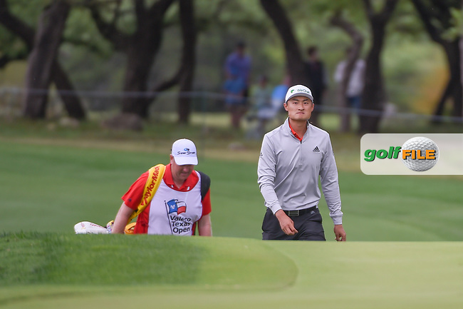HaoTong Li (CHN) approaches the green on 12 during day 4 of the Valero Texas Open, at the TPC San Antonio Oaks Course, San Antonio, Texas, USA. 4/7/2019.<br /> Picture: Golffile | Ken Murray<br /> <br /> <br /> All photo usage must carry mandatory copyright credit (© Golffile | Ken Murray)
