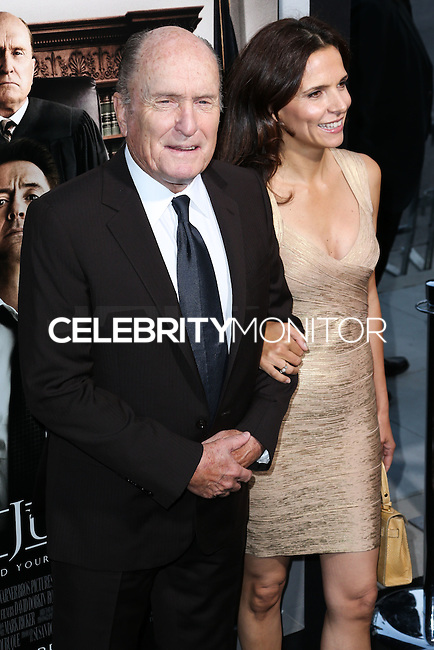 BEVERLY HILLS, CA, USA - OCTOBER 01: Robert Duvall, Luciana Pedraza arrive at the Los Angeles Premiere Of Warner Bros. Pictures And Village Roadshow Pictures' 'The Judge' held at the Samuel Goldwyn Theatre at The Academy of Motion Picture Arts and Sciences on October 1, 2014 in Beverly Hills, California, United States. (Photo by Xavier Collin/Celebrity Monitor)