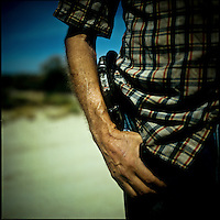 A gun in the pocket of Captain Ron, a local caretaker of a few properties in the Campo area of Southern California, who claims that he has been kidnapped by drug cartels more than once. Due to his living so close to the fence, illegal immigration and the fence play such an constant role in his day to day life.