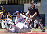 Reno's Conor Allard slides safely home as teammate Hayes Riedeman tells him to slide in the NIAA Division I Northern Region Baseball Championship between the Galena Grizzlies and the Reno Huskies played on Saturday, May 14, 2016 at Peccole Park in Reno, Nevada.