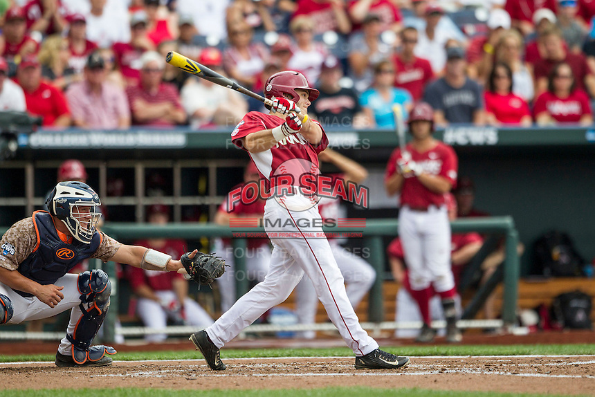 Arkansas Razorbacks outfielder Andrew Benintendi (16) swings the bat against the Virginia Cavaliers in Game 1 of the NCAA College World Series on June 13, 2015 at TD Ameritrade Park in Omaha, Nebraska. Virginia defeated Arkansas 5-3. (Andrew Woolley/Four Seam Images)