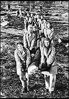 BNPS.co.uk (01202 558833)<br /> Pic:   HistoryPress/BNPS<br /> <br /> Lumberjills at a training camp in Culford near Bury St Edmunds in Suffolk, 1942.<br /> <br /> These inspiring photos tell the little known story of the patriotic women who chopped down trees to help us win the Second World War.<br /> <br /> When war was declared in September 1939 Britain was almost completely dependent on imported timber and only had seven months worth of it stockpiled.<br /> <br /> With men being sent to the front line in their droves, the Woman's Timber Corps was established to fell trees, operate sawmills and run forestry sites.<br /> <br /> About 15,000 women, some as young as 14, volunteered to carry out the arduous tasks previously done by men.