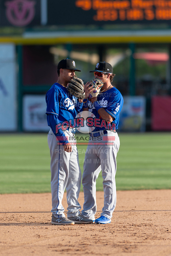 Rancho Cucamonga Quakes infielders Moises Perez (50) and Brandon Montgomery (12) talk during a California League game against the Visalia Rawhide on April 9, 2019 in Visalia, California. Visalia defeated Rancho Cucamonga 8-5. (Zachary Lucy/Four Seam Images)
