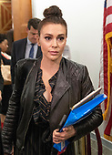 Alyssa Milano departs following the hearing where Judge Brett Kavanaugh attempted to refute the testimony of Dr. Christine Blasey Ford  before the US Senate Committee on the Judiciary on his nomination to be Associate Justice of the US Supreme Court to replace the retiring Justice Anthony Kennedy on Capitol Hill in Washington, DC on Thursday, September 27, 2018.  <br /> Credit: Ron Sachs / CNP<br /> (RESTRICTION: NO New York or New Jersey Newspapers or newspapers within a 75 mile radius of New York City)