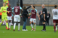 Mark Noble of West Ham tackles pitch invader  during West Ham United vs Burnley, Premier League Football at The London Stadium on 10th March 2018