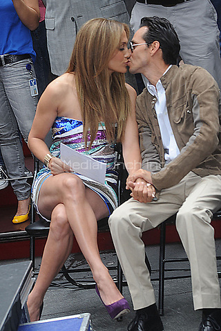 SMG_NY1_Jennifer Lopez_Marc Anthony_Be Extraordinary_061010_23.JPG<br /> <br /> NEW YORK - JUNE 10: Jennifer Lopez and Marc Anthony attend the unveiling of the 'Be Extraordinary ' billboard for Boys and Girls Clubs in Times Square on June 10, 2010 in New York, New York.   <br /> <br /> People:  Jennifer Lopez_Marc Anthony<br /> <br /> Hoo-Me.com / MediaPunch