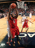 Maryland forward Charles Mitchell (0) grabs a rebound during the game Sunday in Charlottesville, VA. Virginia defeated Maryland in overtime 61-58. Photo/Andrew Shurtleff