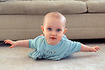 "Berkeley CA Baby girl five-months-old showing off mastery of ""airplane pose"" raising upper body  MR"