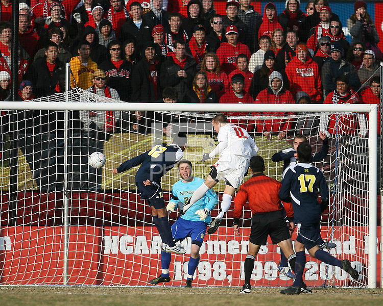 Casey Townsend #11of the University of Maryland headss wide past Chris Blais #23 of the University of Michigan during an NCAA quarter-final match at Ludwig Field, University of Maryland, College Park, Maryland on December 4 2010.Michigan won 3-2 AET.