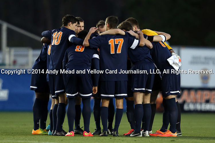 12 December 2014: Virginia starters huddle before the game. The University of Virginia Cavaliers played the University of Maryland Baltimore County Retrievers at WakeMed Stadium in Cary, North Carolina in a 2014 NCAA Division I Men's College Cup semifinal match.