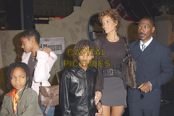 EDDIE MURPHY & FAMILY.attends the Walt Disney's 'Haunted Mansion' L.A. Premiere held at the El Capitan..23/11/2003.www.capitalpictures.com.sales@capitalpictures.com.©Capital Pictures.